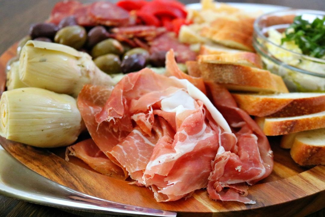 Holiday Antipasto Platter - Use delicious, fresh and store bought ingredients to make an impressive antipasto platter to bring to your next holiday party ~ www.mangiamichelle.com