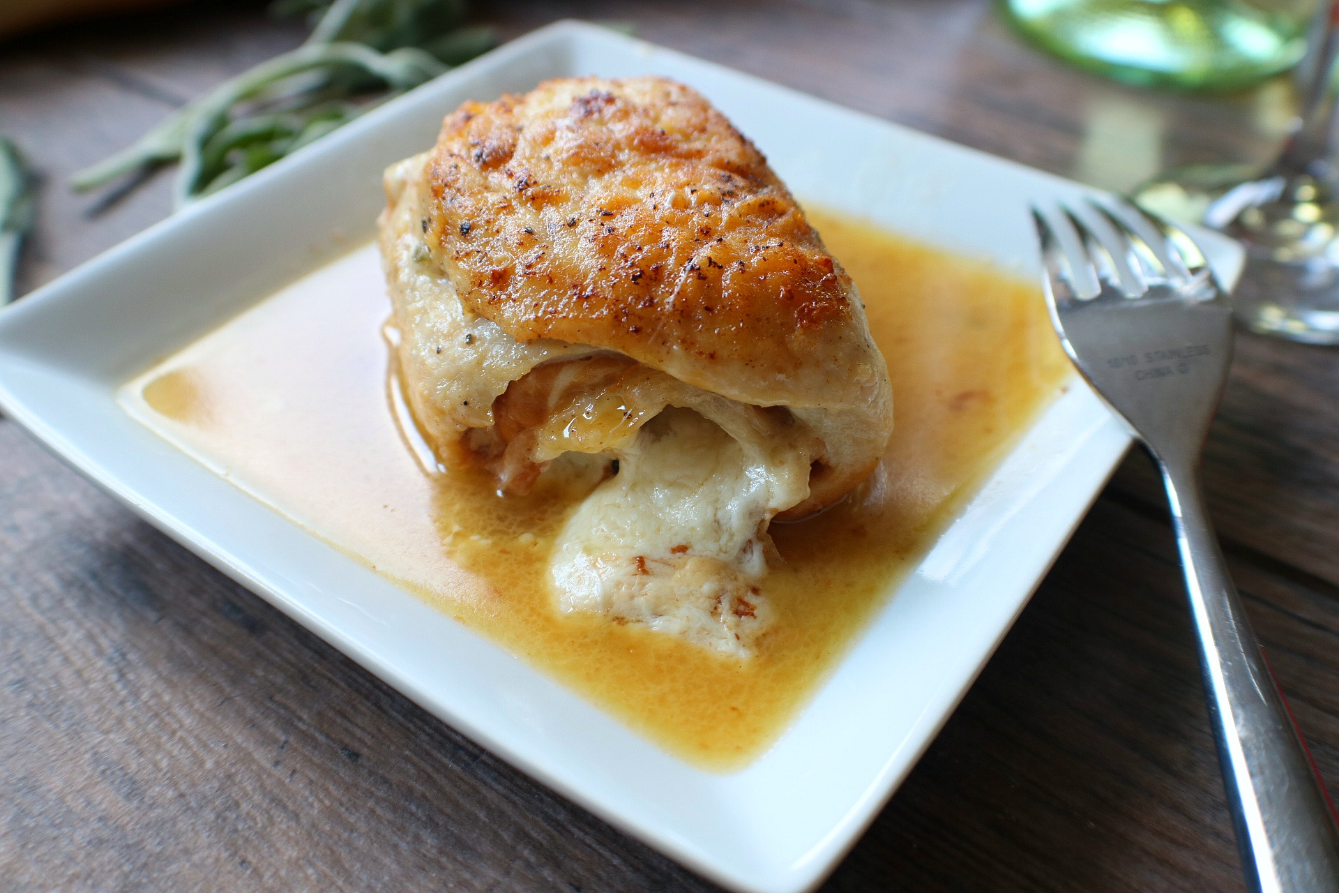 Rolled Chicken Saltimbocca in a white wine sauce