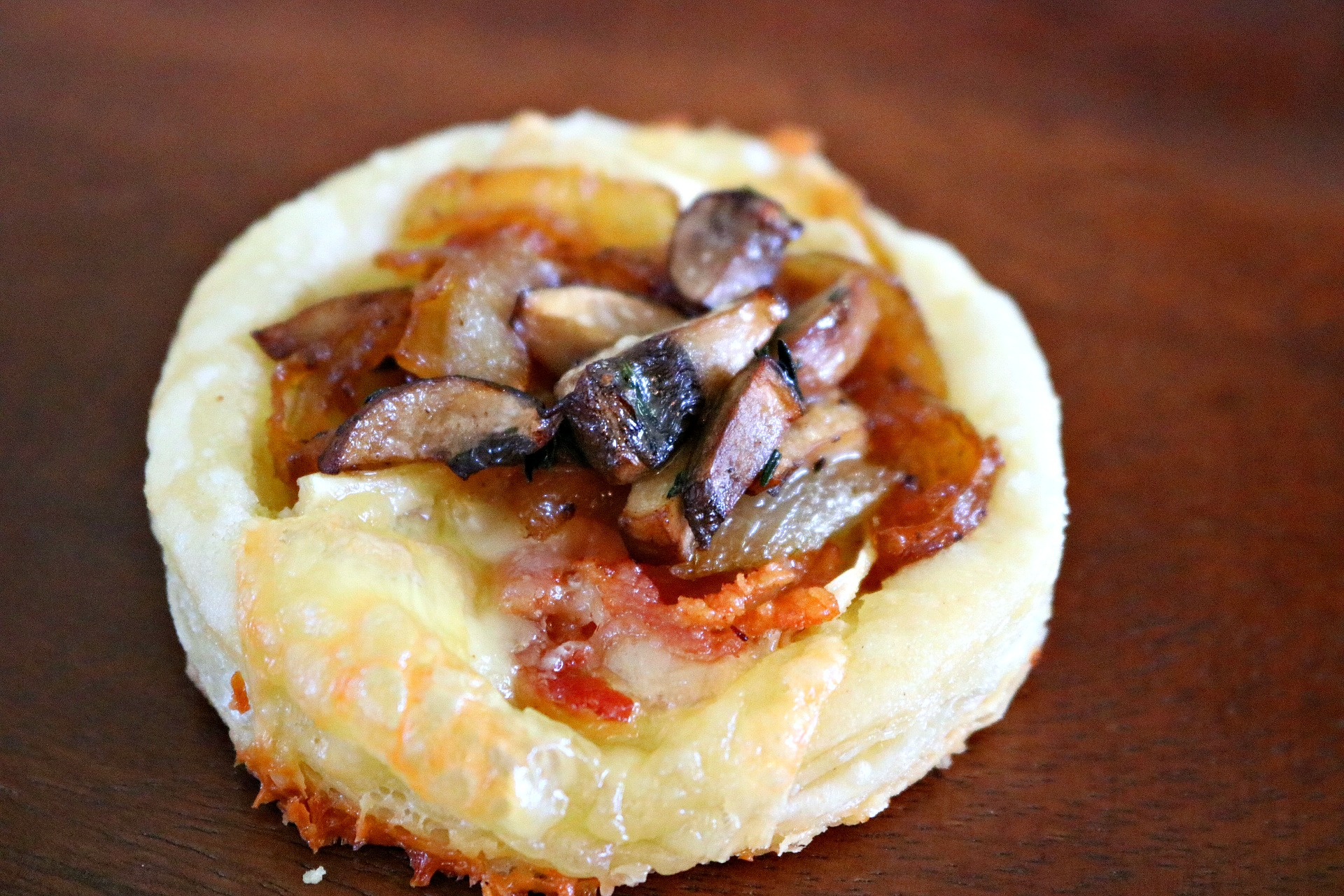 brie, puff pastry, caramelized onions, thyme, mushrooms, bacon