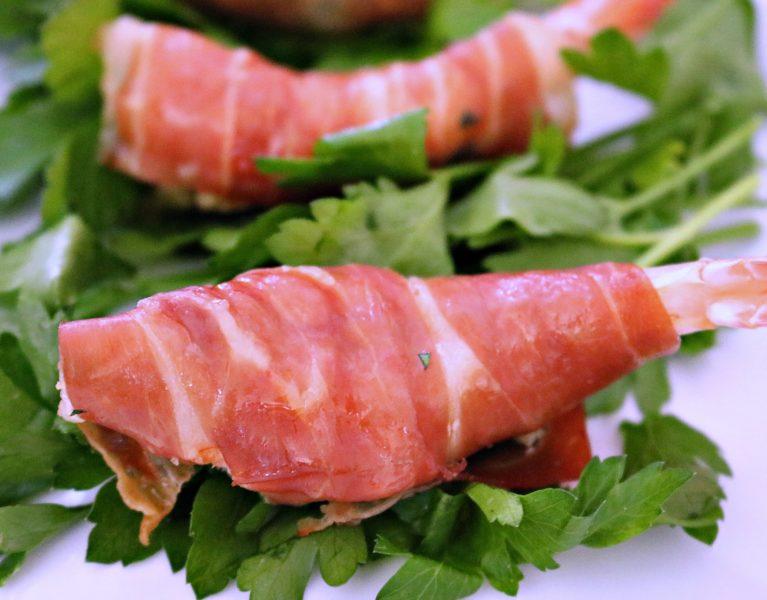 Shrimp wrapped in prosciuttoe table